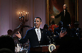 """United States President Barack Obama speaks at a White House event titled In Performance at the White House: Red, White and Blues, February 21, 2012 in Washington, DC.  As part of the In Perfomance series, music legends and contemporary major artists have been invited to perform at  the White House for a celebration of Blues music and in recognition of Black History Month. The program featured performances by B.B. King, Troy """"Trombone Shorty"""" Andrews, Jeff Beck, Gary Clark, Jr., Shemekia Copeland, Buddy Guy, Warren Haynes, Mick Jagger, Keb Mo, Susan Tedeschi and Derek Trucks, with Taraji P. Henson as the program host and Booker T. Jones as music director and band leader. .Credit: Win McNamee / Pool via CNP"""