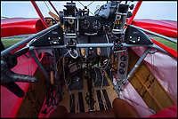BNPS.co.uk (01202 558833)<br /> Pic: PhilYeomans/BNPS<br /> <br /> The cockpit benefits from some essential modern additions along with the butane powered spandau guns.<br /> <br /> Dreaded Red Baron to fly again...WW1 Ace's feared 'Fokker Dreidecker' to finally fly over Britain.<br /> <br /> A German GP based in Norfolk has spent 8 years building a Fokker triplane in his garage as a tribute to infamous WW1 Ace Manfred von Ricthofen, who terrorised the skies over the Western front during the first war.<br /> <br /> Dr Peter Brueggemann, 52, will fulfil his childhood dream and emulate the notorious German fighter pilot when the Dreidecker Dr.1 fighter finally achieves lift-off this summer.<br /> <br /> Dr Brueggemann has even acquired the title Baron from the independent territory of Sealand so he can take to the skies as Baron Peter von Brueggemann in homage to his idol.<br /> <br /> The GP at the Holt Medical Practice in Norfolk hopes to be airborne in a few months once tests on the engine are completed at Felthorpe airfield near Norwich where he has devoted thousands of hours to the project.<br /> <br /> The father-of-two, who has lived in England with wife Sue for 20 years, has been taking flying lessons since his project began.