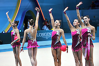 August 31, 2013 - Kiev, Ukraine -  USA RHYTHMIC GROUP waves to fans after ribbon + ball routine at 2013 World Championships.
