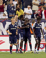 New England Revolution forward Kheli Dube (11) celebrates his goal with teammates. The New England Revolution defeated the Seattle Sounders FC, 3-1, at Gillette Stadium on September 4, 2010.