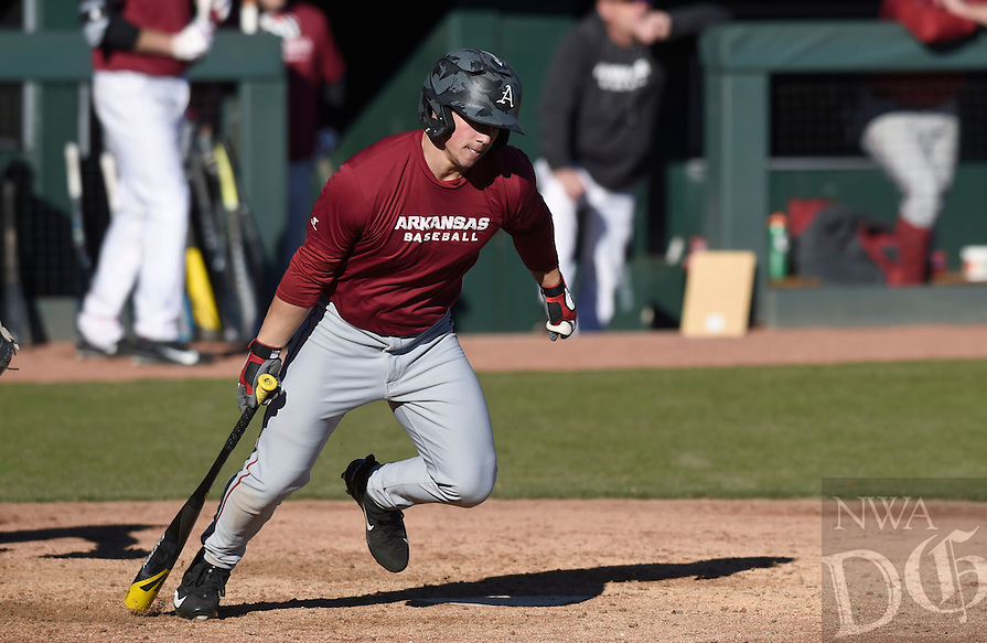 NWA Democrat-Gazette/MICHAEL WOODS @NWAMICHAELW<br /> University of Arkansas outfielder Dominic Fletcher (28) tries to get to first base Friday, January 27, during Razorback baseball teams first practice for the 2017 season at Baum Stadium.