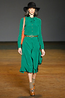 Hind Sahli walks runway in a dragon green michaela silk dress, ochre voyage shoulder bag, and brick patent lace up oxfords, from the Marc by Marc Jacobs Fall/Winter 2011 collection, during New York Fashion Week, Fall 2011.