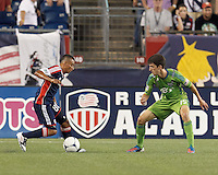 New England Revolution substitute forward Fernando Cardenas (80) on the attack as Seattle Sounders FC substitute midfielder Alvaro Fernandez (15) defends. In a Major League Soccer (MLS) match, the New England Revolution tied the Seattle Sounders FC, 2-2, at Gillette Stadium on June 30, 2012.