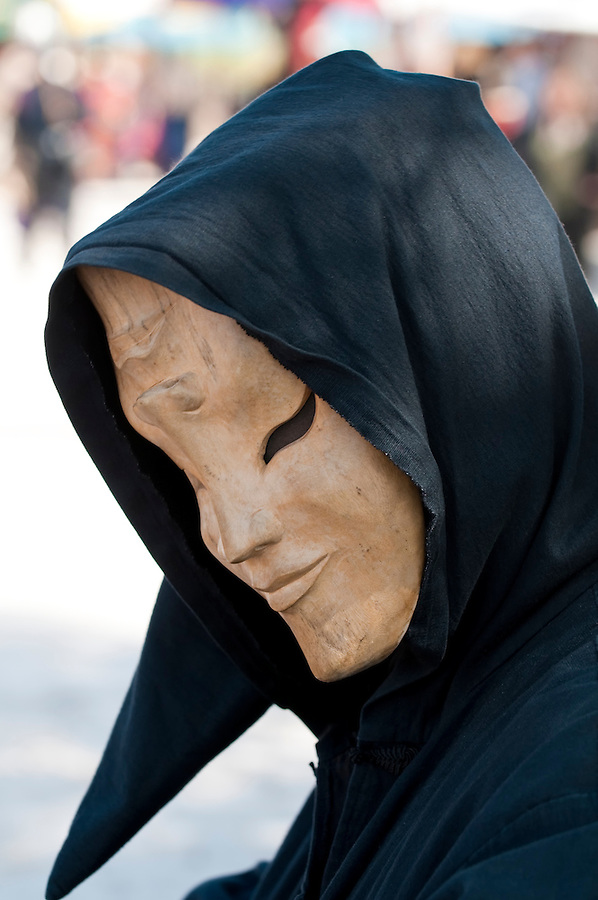 Portrait of man behind a mask in carnival.