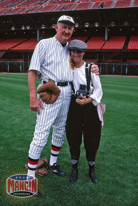 SAN FRANCISCO, CA - Manager Roger Craig of the San Francisco Giants poses with Giants team photographer Martha Jane Stanton before a turn back the clock game against the Chicago Cubs at Candlestick Park in San Francisco, California on June 23, 1991. (Photo by Brad Mangin)