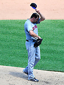 New York Mets pitcher Johnathan Niese (49) wipes perspiration from his brow in the fifth inning against the Washington Nationals at Nationals Park in Washington, D.C. on Sunday, July 31, 2011.  .Credit: Ron Sachs / CNP.(RESTRICTION: NO New York or New Jersey Newspapers or newspapers within a 75 mile radius of New York City)