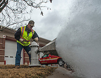 NWA Democrat-Gazette/ANTHONY REYES @NWATONYR<br /> Ken Mitchell, with the Rogers Water Utilities, turns on the water supply Tuesday, Feb. 14, 2017 at a fire hydrant at First Street and Maple Street in Rogers. The test measured the flow rate for the hydrant to help plan the water needs for new construction across the road.