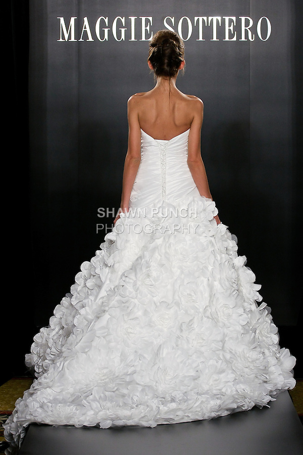 Model walks the runway in a Whitney wedding dress from the Sottero and Midgley Spring 2012 collection, during  Couture: New York Bridal Fashion Week 2012