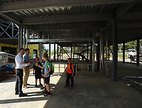 NWA Democrat-Gazette/ANDY SHUPE<br /> Phil Schwartz (left), head of the Upper School at The New School, leads a tour Wednesday, April 19, 2017, for a group of students in what will be a robotics lab adjacent to the school's Innovation Center during a beam raising and tour of the school's expansion project in Fayetteville. The New School hopes to open the facility in the fall for the 2017-18 school year.