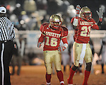 Lafayette High's Kalen Coleman (16) and Lafayette High's Josh Barry (21) celebrate a Commodore fumble recovery vs. Louisville in MHSAA 4A playoff action at William L. Buford Field in Oxford, Miss. on Friday, November 18, 2011. Lafayette won 28-6 and will advance to play Amory.