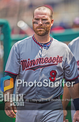 9 June 2013: Minnesota Twins catcher Ryan Doumit walks the dugout during a game against the Washington Nationals at Nationals Park in Washington, DC. The Nationals shut out the Twins 7-0 in the first game of their day/night double-header. Mandatory Credit: Ed Wolfstein Photo *** RAW (NEF) Image File Available ***