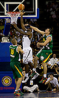 US forward (6) LeBron James scores as he is fouled by Lithuania forward (6) Jonas Maciulis with (15) Robertas Javtokas looking on while playing at the Cotai Arena inside the Venetian Macau Resort and Hotel.  The US defeated Lithuania, 120-84.