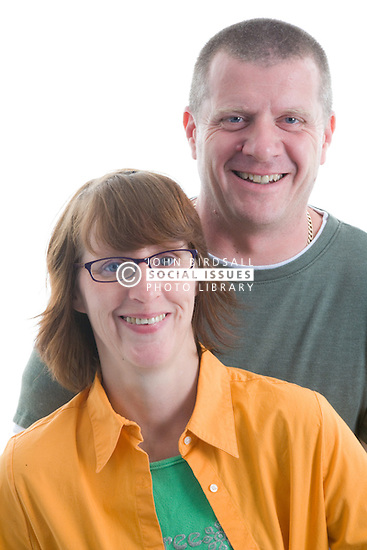 Portrait of a couple in the studio smiling,