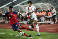 United Arab Emirates' Ali Mabkhoot (7) pressures Costa Rica's Jose Mena (2) during the FIFA Under 20 World Cup Quarter-final match at the Cairo International Stadium in Cairo, Egypt, on October 10, 2009. Costa Rica won the match 1-2 in overtime play.