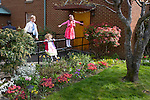 Kids having fun after Easter mass, in their Sunday best. Queen of Angels Catholic church, Port Angeles WA