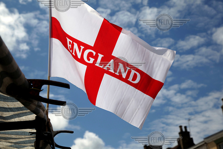 An English Cross of St George flag flies from a market stall. <br /> The town of Boston had the country's highest proportion of 'leave' votes cast in the EU referendum with almost 76 percent of ballots cast for Brexit. Lincolnshire has, in recent years, seen an influx of EU workers drawn to the area's agricultural industry. The 2011 census found about 13 percent of Boston's residents were born in Eastern Europe and migrated to the UK since 2004.
