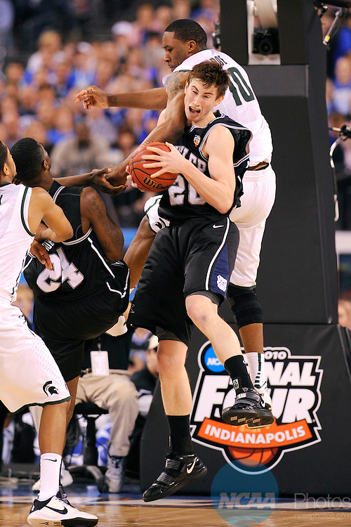 3 APR 2010: Gordon Hayward (20) of Butler University pulls down a rebound in front of Delvon Roe (10) of Michigan State during the semi final game of the Men's Final Four Basketball Championships held at Lucas Oil Stadium in Indianapolis, IN. Butler University went on to defeat Michigan State University 52-50 to advance to the championship game. Ryan McKee/NCAA Photos