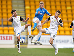 St Johnstone v Inverness Caley Thistle...02.05.15   SPFL<br /> David Wotherspoon battles with Danny Williams and Greg Tansey<br /> Picture by Graeme Hart.<br /> Copyright Perthshire Picture Agency<br /> Tel: 01738 623350  Mobile: 07990 594431