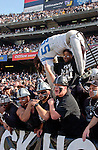 "Raider fans in the ""Black Hole"" use dummy with number 55 on it to intimidate San Diego Chargers linebacker Junior Seau (55) on Sunday, November 18, 2001, in Oakland, California. The Raiders defeated the Chargers 34-24."