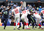 New York Giants quarterback Eli Manning passes under pressure from Seattle Seahawks  defensive tackle Brandon Mebane (92), defensive end Cliff Avril (56) and defensive end Michael Bennett (72)  at CenturyLink Field in Seattle, Washington on November 9, 2014. The Seahawks  beat the Giants 38-17.       ©2014. Jim Bryant Photo. All rights Reserved.