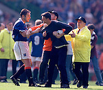Ally McCoist's last match for Rangers ends in a shambles after the Scottish Cup Final defeat in 1998 as an angry Hearts fan runs on to the pitch to confront him. McCoist wore number 12 that afternoon