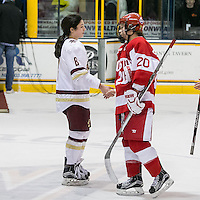 North Andover, Massachusetts - March 6, 2016: NCAA Division I, Women's Hockey East final. Boston College (white/maroon) defeated Boston University (red), 5-0, at Lawler Arena at Merrimack College. Boston College has a perfect Hockey East season - regular season, Bean Pot winner, and Women's Hockey East winner. Ceremonial handshake begins.