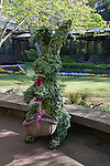 Topiary Easter rabbit and egg (painted pinecones) basket in Sibley Horticultural Center at Callaway Gardens in Pine Mountain, Georgia. Callaway Gardens, which is especially famous for its azaleas, boasts 13,000 acres of gardens and Georgia countryside, plus a conservation nature preserve, extensive education programs, and a very impressive resort as well.
