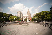 A NYC Dept. of Parks worker cleans the fountain in Washington Square Park, temporarily shut down for maintenance, on Friday, July 19, 2013. The fountain is normally filled with hot New Yorkers and visitors seeking a respite from the heat. The heat wave the city is experiencing is into its fifth day with temperatures in the high 90's with the heat index, a amalgam of heat and humidity,  poised to reach 105 degrees.  ( © Richard B. Levine)