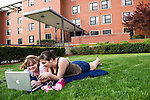 05/06/2011 - Medford/Somerville, Mass.  Carolyn Sween, A14, and Clara Logan, A14, prepare to say goodbye to campus and hello to summer as they hang out on the lawn in front of Miller Hall on Friday, May 6, 2011.  (Alonso Nichols/Tufts University).