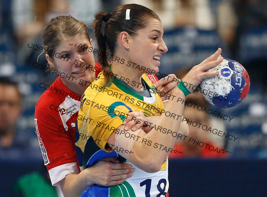 BELGRADE, SERBIA - DECEMBER 20:  Eduarda Amorim (Ro of Brazil is challenged by  Line Anna Ryborg Jorgensen (L) of Denmark  on during the World Women's Handball Championship 2013 Semi Final match between Brazil and Denmark at Kombank Arena Hall on December 20, 2013 in Belgrade, Serbia. (Photo by Srdjan Stevanovic/Getty Images)