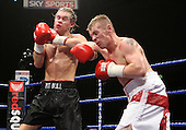 Chas Symonds (red/white shorts, Croydon) defeats Alex Spitko (Mansfield, black shorts) in a Welterweight contest at Goresbrook Leisure Centre, Dagenham, Essex promoted by Frank Maloney / FTM Sports - 18/07/08 - MANDATORY CREDIT: Gavin Ellis/TGSPHOTO - Self billing applies where appropriate - Tel: 0845 094 6026.
