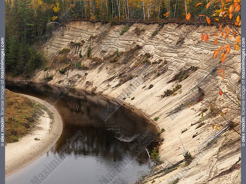 Erosion of a bank on a bend of Big East River. Arrowhead provincial park, Ontario, Canada.