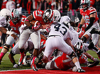 Ohio State Buckeyes running back Carlos Hyde (34) rumbles into the end zone over Penn State Nittany Lions linebacker Mike Hull (43) for a touchdown during the first half of the NCAA football game at Ohio Stadium in Columbus on Oct. 26, 2013. (Adam Cairns / The Columbus Dispatch)