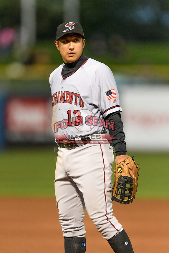 Jae-Gyun Hwang (13) of the Sacramento River Cats on defense against the Salt Lake Bees in Pacific Coast League action at Smith's Ballpark on April 11, 2017 in Salt Lake City, Utah. The River Cats defeated the Bees 8-7. (Stephen Smith/Four Seam Images)