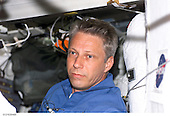 In Earth Orbit - July 6, 2006 -- Astronaut Thomas Reiter, who represents the European Space Agency, is shown on the middeck of the Space Shuttle Discovery but will soon be moving into his new duties as the third member of the Expedition 13 crew onboard the International Space Station..Credit: NASA via CNP