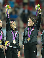 London, England - Thursday, August 9, 2012: The USA defeated Japan 2-1 to win the London 2012 Olympic gold medal at Wembley Stadium.  Alex Morgan and Abby Wambach wave to the crowd. .
