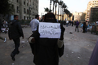 A protester at Tahrir Square in Cairo holds a sign calling for President Hosni Mubarak to be brought to trial.