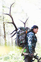 COURTESY PHOTO HANNAH CICIONI<br /> Cicioni hunts solo so there was no one to take pictures of her packing out her elk. When she got back to Rogers, she recreated the pack-out for this photo.
