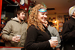 Psychology senior Heather Greathouse enjoys a beer during the Mardi Gras celebration at Bourbon and Toulouse in Lexington, Ky., on Tuesday, February 12, 2013. Photo by Genevieve Adams | Staff