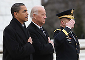 Arlington, VA - January 18, 2009 -- United States President-elect Barack Obama and Vice President elect Joseph Biden and Major General Richard Rowe , Commander Military District of Washington, pay their respects at the Tomb of the Unknown Soldier at Arlington National Cemetery in Arlington, Virginia on Sunday, January 18, 2009..Credit: Dennis Brack - Pool via CNP