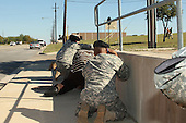Fort Hood, TX - November 5, 2009 -- Bystanders crouch for cover as shots rang out from Fort Hood's Soldier Readiness Processing Center Thursday, November 5, 2009, as law enforcement officers run toward the sound of the gun. A lone gunman killed 13 people and wounded 30 more in the incident. .Mandatory Credit: Jeramie Sivley - U.S. Army via CNP