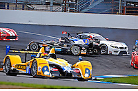#88 ORECA FLM-09 , Duncan Ende, Bruno Junquiera, spins in turn one, Brickyard Grand Prix, Indianapolis Motor Speedway, Indianapolis, Indiana, July 2014.  (Photo by Brian Cleary/www.bcpix.com)
