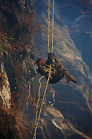 Barehanded and barefoot, with his face unprotected, the Perengge endures repeated attacks by the bees while hanging in acrobatic positions without anything to protect him from a fall as he moves along the ladder. Some cliffs bear the names of those who lost their lives there.