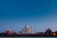 The Taj Mahal North Side and Mosque viewed across Yamuna River at sunset , India