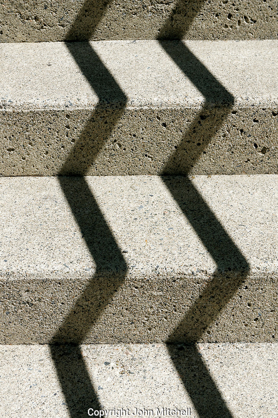 Zigzagging shadows cast on concrete steps