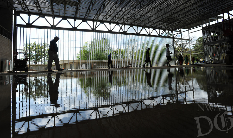 NWA Democrat-Gazette/ANDY SHUPE<br /> Visitors walk Wednesday, April 19, 2017, through the partially completed gymnasium during a beam raising and tour of The New School's expansion project in Fayetteville. The New School hopes to open the facility in the fall for the 2017-18 school year.