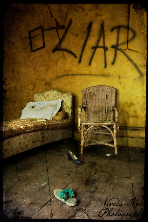 Chair and chaise longue in an abandoned bedroom