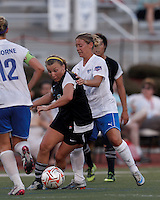 New England Mutiny midfielder Riley Houle (2) dribbles as Boston Breakers substitute midfielder Mary Frances-Monroe (29) pressures. In a Women's Premier Soccer League Elite (WPSL) match, the Boston Breakers defeated New England Mutiny, 4-2, at Dilboy Stadium on June 20, 2012.