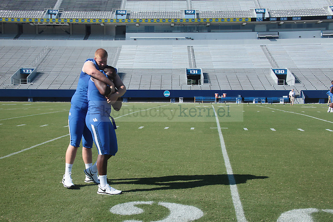 Alvin Davis Jr. and John Gruenschlaeger at UK Football media day in Lexington, Ky., on Monday, August 5th, 2013. Photo by Ellie Hasken | Staff