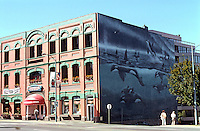 """Victoria: McQuade's Ship Chandlers. Architecture John Teague. Mural """"A 5-Pod"""" by Robert Wyland.  Foot of Yates St.  Photo '88."""
